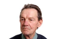 Um homem idoso que olha algo Imagem de Stock Royalty Free