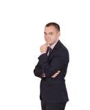 Um homem na roupa do estilo do negócio no fundo branco fotos de stock
