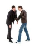 Um homem novo bate para fora um homem de negócios. Foto de Stock Royalty Free