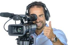 Um homem novo com a câmera de filme profissional Imagens de Stock
