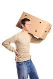 Um homem novo que sofre da dor traseira Fotografia de Stock