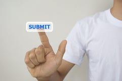 Um homem que usa a relação digital com seus dedos submete o botão Imagem de Stock Royalty Free