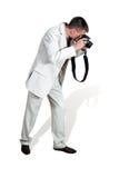 Um homem vestido como fotografias. Fotografia de Stock