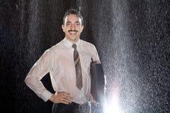 Homem de negócios bem sucedido na chuva Fotografia de Stock Royalty Free