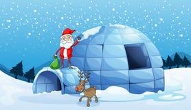 Um igloo e um Papai Noel Fotos de Stock Royalty Free