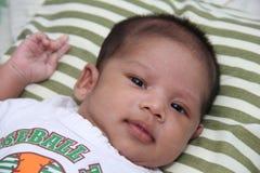 Um infante de sorriso Imagens de Stock