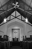Um interior antigo da igreja Foto de Stock