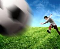 Um jogador de futebol Imagem de Stock