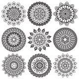 Um jogo de mandalas e de círculos bonitos do laço Imagem de Stock Royalty Free