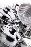 Um jogo dos saucepans, aço inoxidável Imagem de Stock