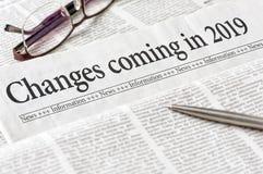 Um jornal com as mudanças do título que vêm em 2019 foto de stock royalty free