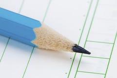 Um lápis e um caderno fotos de stock