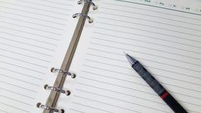 Um lápis no caderno Fotografia de Stock