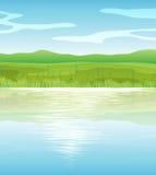 Um lago azul calmo Fotografia de Stock Royalty Free