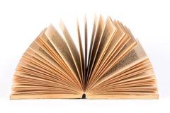 Um livro velho aberto no fundo branco imagem de stock royalty free