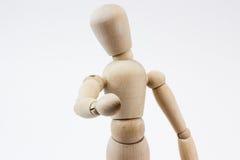 Um manequim de madeira que aponta em nós Imagem de Stock
