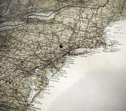 Um mapa da costa leste de América, pino do impulso em NY fotos de stock royalty free