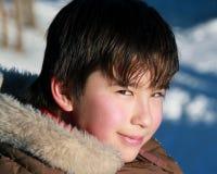 Um menino asiático snicky Fotografia de Stock Royalty Free