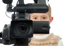 Um menino com a câmara de vídeo Fotografia de Stock