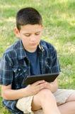 Criança com tabuleta Imagens de Stock