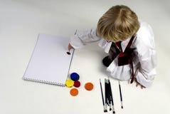 Um menino do negócio está pintando Imagens de Stock Royalty Free