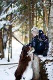 Um menino e seu cão Foto de Stock Royalty Free