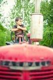 Um menino e seu trator Fotografia de Stock Royalty Free