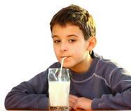 Um menino e um leite foto de stock royalty free
