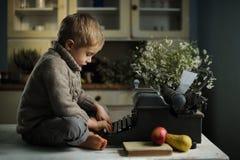 Um menino em uma casa velha Imagens de Stock Royalty Free