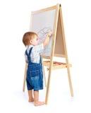 Um menino está desenhando em um quadro-negro Imagens de Stock Royalty Free