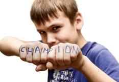 Um menino está em uma pose da luta, com as palavras imagem de stock royalty free