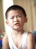 Um menino irritado Imagem de Stock Royalty Free