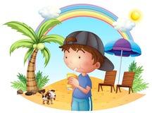 Um menino novo na praia com seu animal de estimação ilustração royalty free