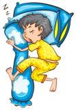 Um menino novo que dorme sadiamente Imagem de Stock
