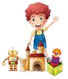 Um menino que acena sua mão com brinquedos Imagem de Stock