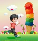 Um menino que corre no candyland Foto de Stock