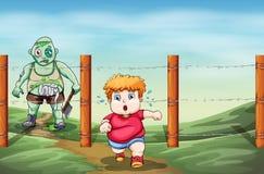 Um menino que esteja receoso de um zombi Fotos de Stock Royalty Free