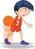 Um menino que joga o basquetebol Imagens de Stock Royalty Free