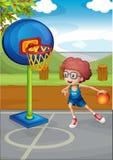Um menino que joga o basquetebol ilustração royalty free