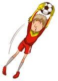 Um menino que joga o futebol Fotografia de Stock Royalty Free