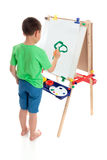 Um menino que pinta um retrato Fotografia de Stock Royalty Free