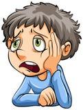 Um menino triste Fotos de Stock