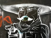 Um mexicano com uma arma, grafitti imagens de stock royalty free