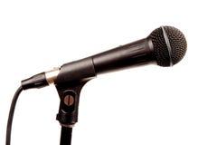 Um microfone preto no branco Fotos de Stock