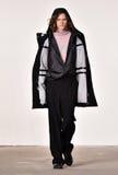 Um modelo anda a pista de decolagem no desfile de moda de Tim Coppens durante a queda dos homens da semana de moda de New York/in Imagem de Stock Royalty Free