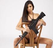 Biquini com armas Fotos de Stock