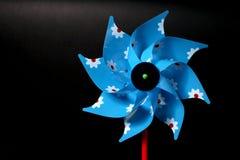 Um moinho de vento colorido isolado Fotografia de Stock