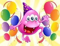 Um monstro cor-de-rosa do beanie no meio dos balões Foto de Stock