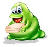 Um monstro do greenslime que tem um trabalho novo Fotografia de Stock Royalty Free