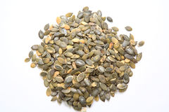 Um montão de sementes de abóbora fotografia de stock